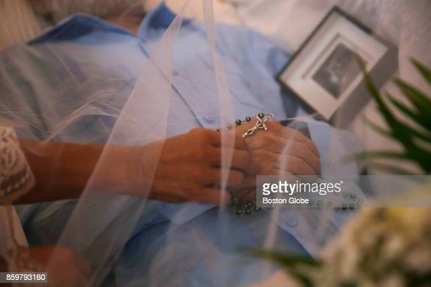 Ana Ruiz reaches out to adjust the rosary beads on her husband's hand during his wake in Corozal Puerto Rico on Oct 02 2017 After Hurricane Maria...