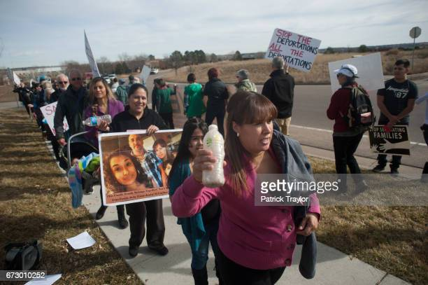 Ana Sauzameda of Denver followed by her daughter Andrea attended a rally outside the Immigration and Customs Enforcement office Feb 12 2015 on Caley...