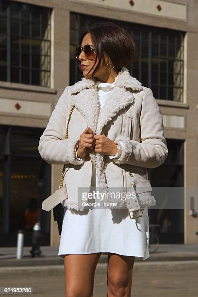 Ana Sousa wearing cream Ecru suede and fleece shearling Zara jacket short white Aline cotton dress with ruffle neck shoulders and sleeves by Zara...