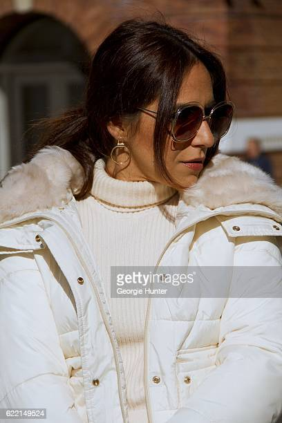 Ana Sousa wearing Ecru white ribbed knit sweater with polo neck and long sleeves with slit from Zara white short anorak jacket with poppers oversized...