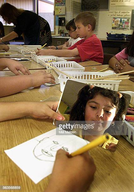 Ana Topete works on drawing a self portrait during art class that is part of core knowledge curriculum at Peach Hill Elementary School in Moorpark