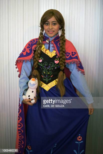 Ana Vitoria Viera wears a costume resembling the character Anna from the Disney film Frozen at The Geek and Game Expo in Rio de Janeiro on July 21...