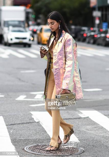 Anaa Saber is seen wearing an Area coat and Martineali pants outside the Area show during New York Fashion Week S/S20 on September 07, 2019 in New...