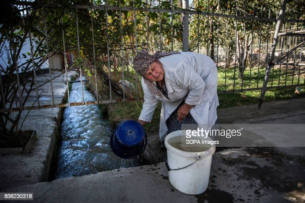 Anabar Nosirova who is employed as a kitchen worker at the Beshkent school gathers 80100 liters of water each afternoon She filters the water through...
