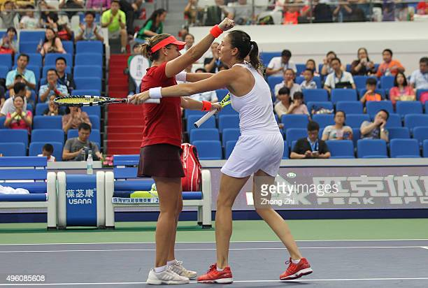 Anabel Medina Garrigues of Spain and Arantxa Parra Santonja of Spain react during the doubles match against Gabriela Dabrowski of Canada and Alicja...