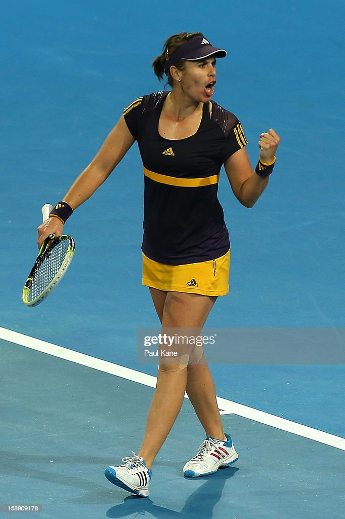 Anabel Medina Garrigues of Spain celebrates winning her singles match against Mathilde Johansson of France during day two of the Hopman Cup at Perth Arena on December 30, 2012 in Perth, Australia.