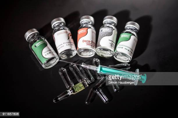 Anabolic steroids and performanceenhancing drugs such as super susto decadurabolin testdyne rapid nandrolone testosterone and a syringe photographed...