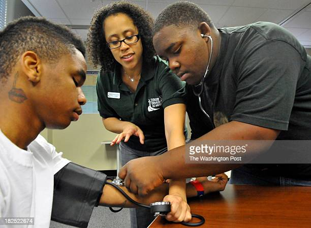 Anacostia high school sophmore Tre Ruffin16 had his blood pressure checked by Derrick Jones a sophmore from Ballou high school with help from Dr...