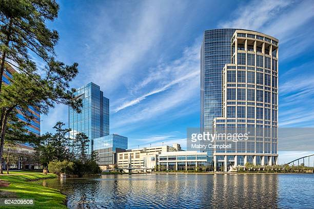 anadarko petroleum corporation - allison tower and hackett tower on the lake - hackett stock photos and pictures