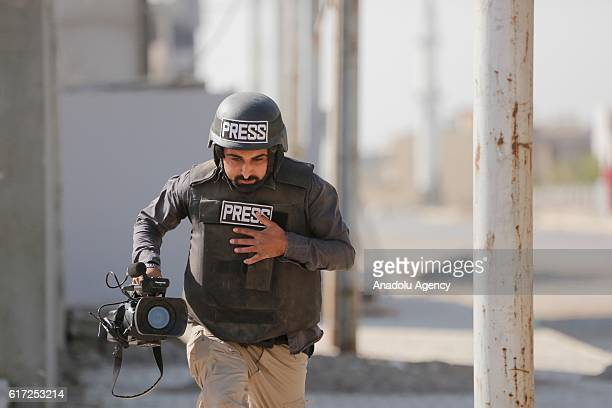 Anadolu Agency cameraman Ihsan Muhammed runs away as an armed attack is staged on a vehicle containing an AA team entering the region where suicide...