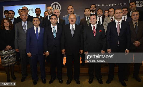 Anadolu Agency DirectorGeneral and Board Chairman Kemal Ozturk Turkish Airlines' Board Chairman Hamdi Topcu and other participants pose after a...