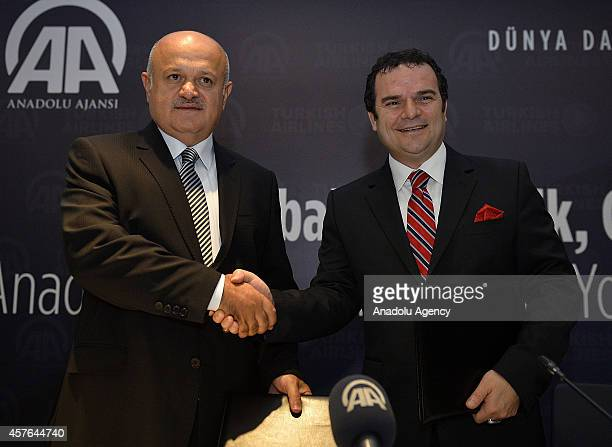 Anadolu Agency DirectorGeneral and Board Chairman Kemal Ozturk shakes hand with Turkish Airlines' Board Chairman Hamdi Topcu after a signing ceremony...
