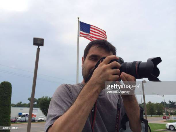 Anadolu Agency's correspondent in the US Bilgin Sasmaz is seen in Ferguson United States on August 20 2014 Police threatened the life of an Anadolu...