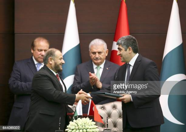 Anadolu Agency's Deputy Director General and EditorinChief Metin Mutanoglu and Executive Director of Associated Press of Pakistan Sohail Ali Khan...