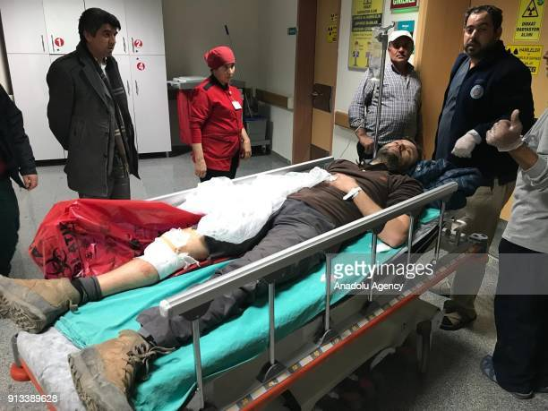 Anadolu Agency's journalist Sarp Ozer is seen on a stretcher at Kirikhan State Hospital in the border province of Hatay Turkey on February 2 2018 A...
