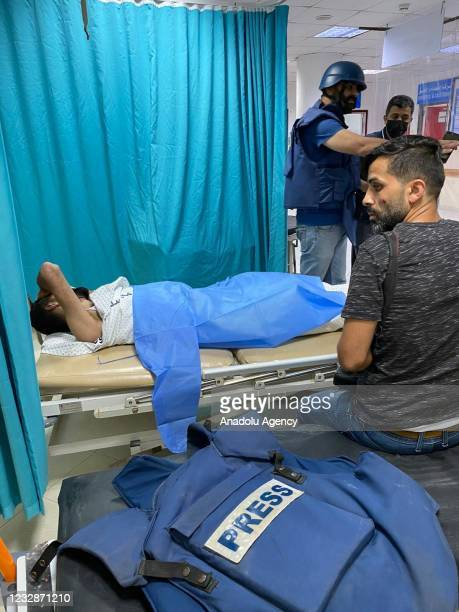 Anadolu Agency's photojournalist Mustafa Hassouna and cameraman Mohammad al-Aloul are transferred to Indonesian hospital for treatment after they...
