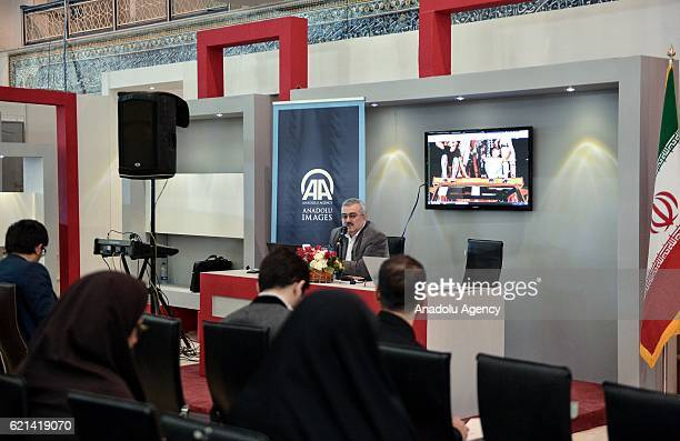Anadolu Agency's Tehran office representative Mustafa Melih Ahishali speaks during the presentation of Anadolu Agency photos and footage taken during...