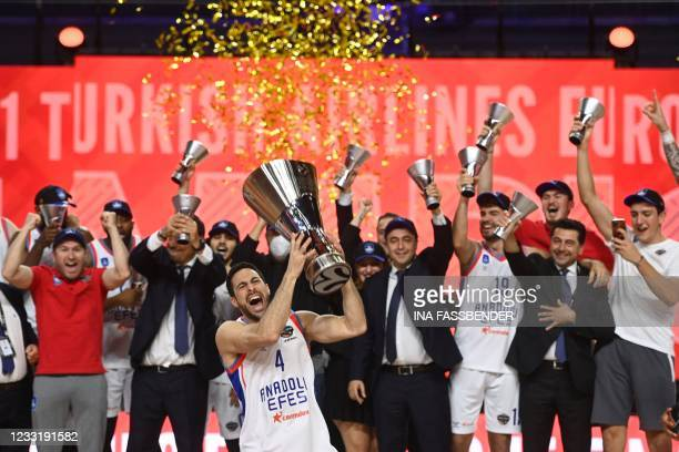 Anadolu Efes Istanbul's Dogus Balbay holds up the trophy as he celebrates with his team after the Basketball Euroleague Final Four championship final...