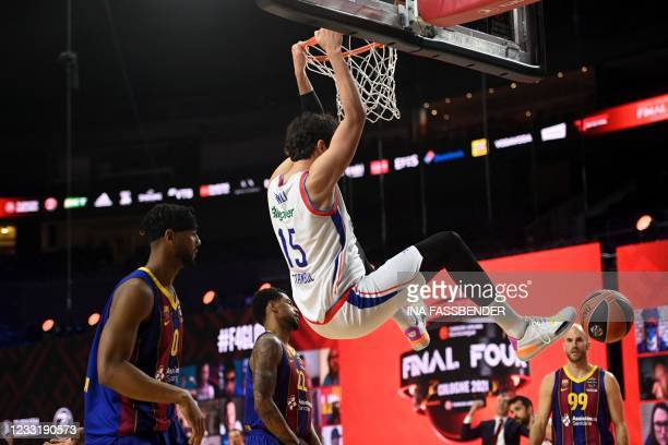 Anadolu Efes Istanbul's Sertac Sanli scores during the Basketball Euroleague Final Four championship final match between FC Barcelona and Anadolu...