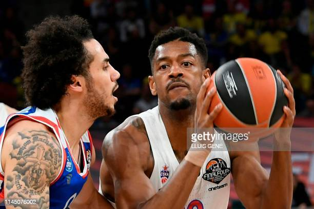 Anadolu Efes' US guard Shane Larkin challenges CSKA Moscow's US guard Cory Higgins during the EuroLeague final basketball match between Anadolu Efes...