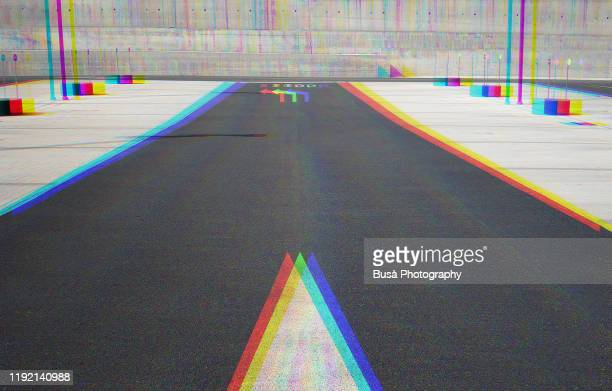 """anaglyph image of arrow and """"stop"""" road marking on asphalt - road marking stock pictures, royalty-free photos & images"""