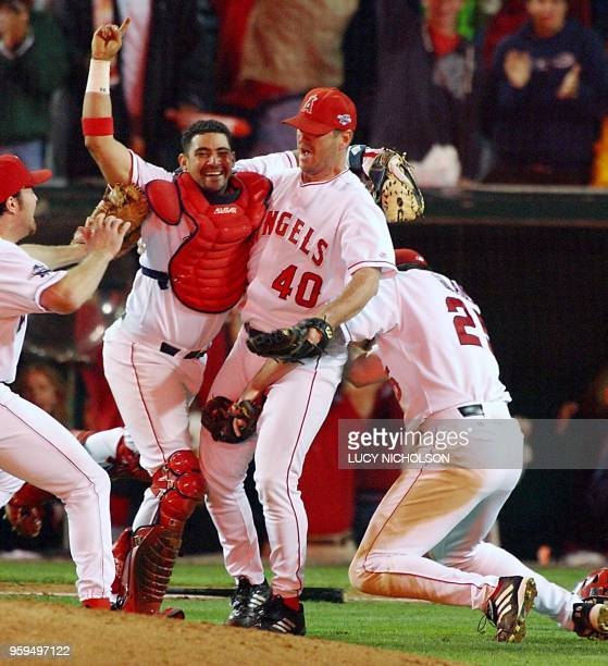 Anaheim Angels' catcher Bengie Molina closing pitcher Troy Percival and Troy Glaus the World Series Most Valuable Player celebrate the last out of...