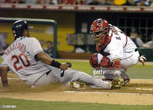 Anaheim Angels catcher Bengie Molina tags out Ronnie Belliard of the Cleveland Indians at home plate in the fourth inning of a 85 loss at Angel...
