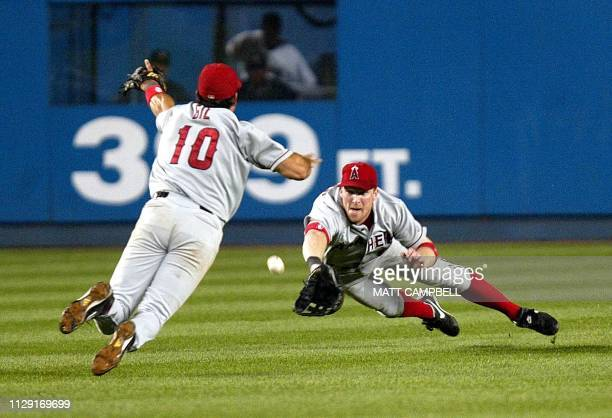Anaheim Angels' center fielder Darren Erstad and second baseman Benji Gil dive for a double hit by the New York Yankees' Juan Rivera in the fourth...