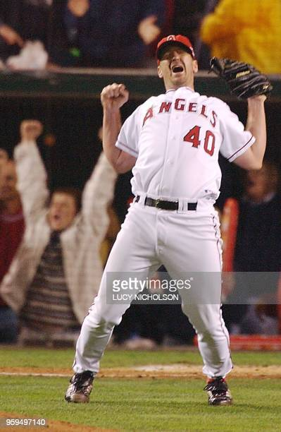 Anaheim Angels' closing pitcher Troy Percival celebrates the last out of Game Seven of the World Series 27 October 2002 in Anaheim against the San...