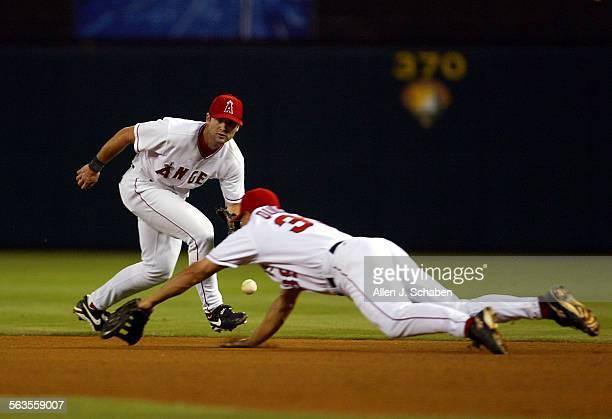 Anaheim Angels first baseman Robb Quinlan right dives as second baseman Adam Kennedy left fields New York Yankees Hideki Matsui's fourth–inning...
