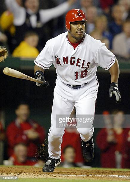 Anaheim Angels' Garret Anderson runs after hitting a three-run double against the San Francisco Giants in the third inning of Game Seven of the World...