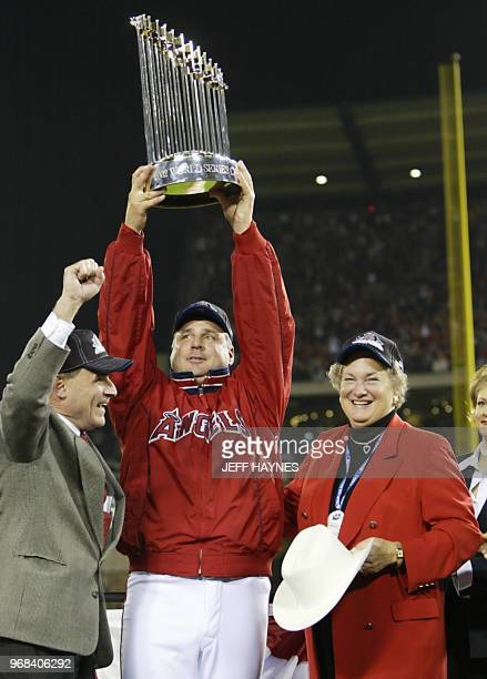 Anaheim Angels' General Manager Bill Stoneman manager Mike Scioscia and Jackie Autry widow of late Angels' owners Gene Autry celebrate after Game...