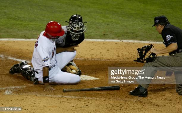 Anaheim Angels left fielder Garret Anderson is out at home as San Francisco Giants catcher Benito Santiago puts on the tag for the second out of the...