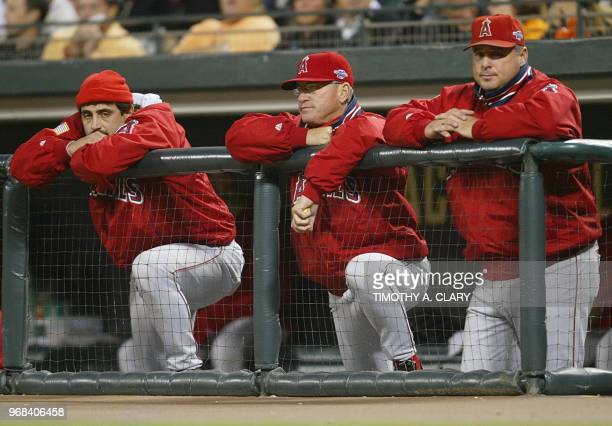 Anaheim Angels manager Mike Scioscia and members of his coaching staff watch his team play the San Francisco Giants in Game Five in the World Series...