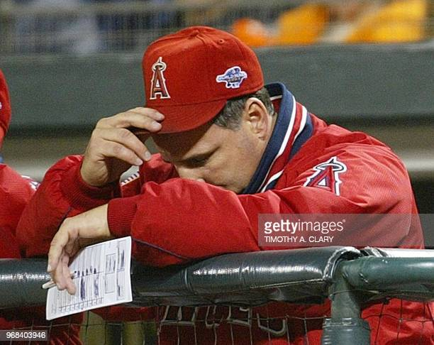 Anaheim Angels' manager Mike Scioscia hangs his head after the San Francisco Giants hit a series of homeruns late in Game Five of the World Series in...