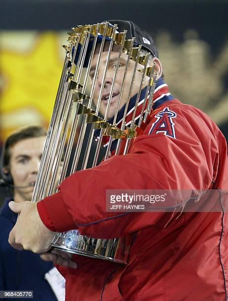 Anaheim Angels' manager Mike Scioscia holds the World Series trophy after Game Seven of the World Series 27 October 2002 in Anaheim The Angels won...