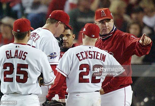 Anaheim Angels manager Mike Scioscia signals the bullpen to replace starting pitcher Kevin Appier during a pause in play against the San Francisco...