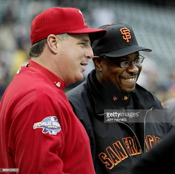 Anaheim Angels manager Mike Scioscia talks to San Francisco Giants Dusty Baker before the start of Game Three of the World Series in San Francisco 22...