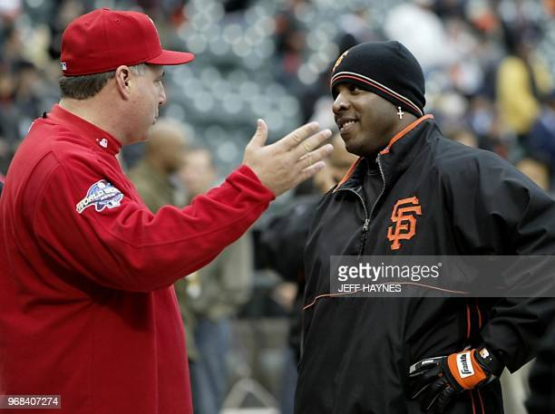 Anaheim Angels manager Mike Scioscia talks to San Francisco Giants slugger Barry Bonds before the start of Game Three of the World Series in San...