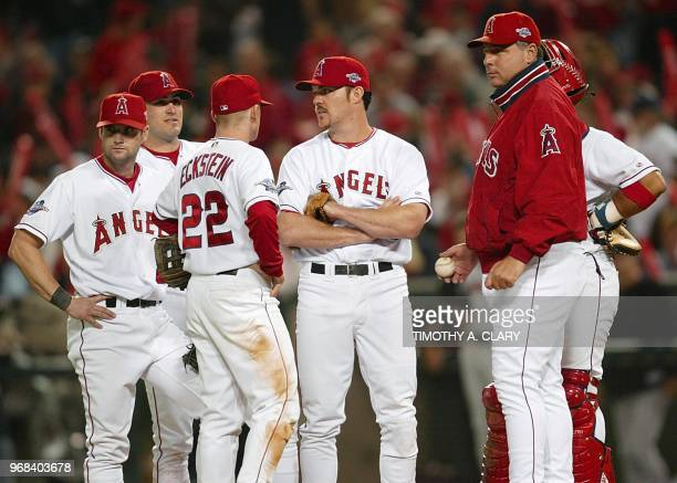 Anaheim Angels manger Mike Scioscia stands on the pitchers mound with members of the Angels infield after pitcher Kevin Appier was sent off in the...