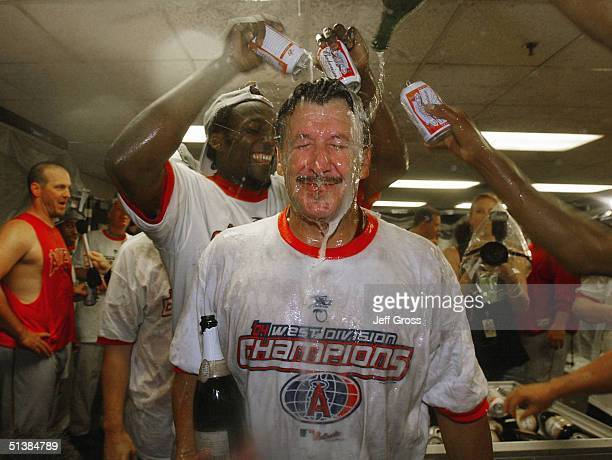 Anaheim Angels owner Arturo Moreno is showered with beer by Vladimir Guerrero following the Angels 54 victory over the Oakland A's to clinch the AL...