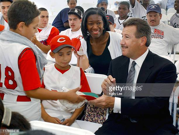 Anaheim Angels owner Arturo Moreno signs autographs for members of the Compton CBATS age 10 and under youth baseball team at ground breaking for...