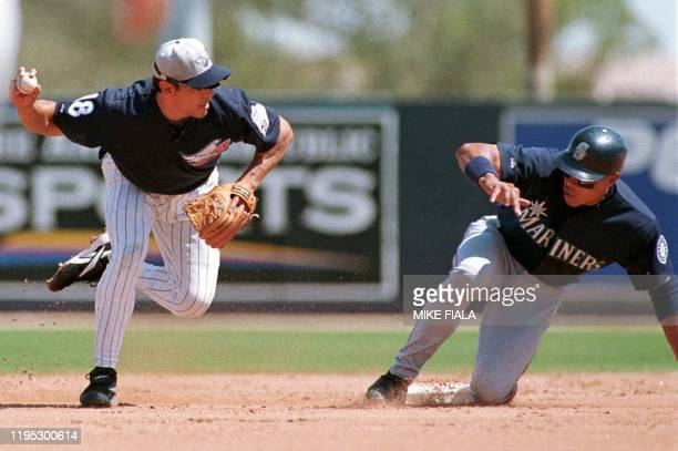 Anaheim Angels second baseman Randy Velarde forces out Seattle Mariners David Segui at second base as he attempts to throw out Jay Buhner at first...