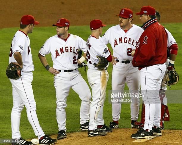 Anaheim Angels' Troy Glaus Adam Kennedy David Eckstein Scott Spiezio manager Mike Scioscia and catcher Bengie Molina stand on the mound as they wait...