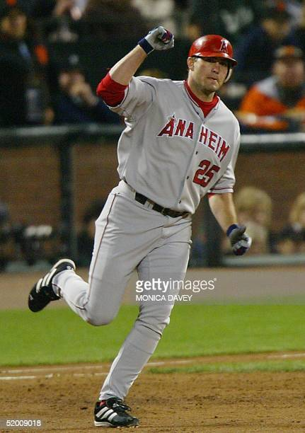 Anaheim Angels' Troy Glaus pumps his fist as he rounds the bases after hitting a two run homerun against the San Francisco Giants in the third inning...