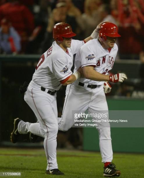 Anaheim DH Brad Fullmer celebrates with Scott Angels first baseman Scott Spiezio after Spezio's 3-run-home run in the seventh inning. The homer cut...