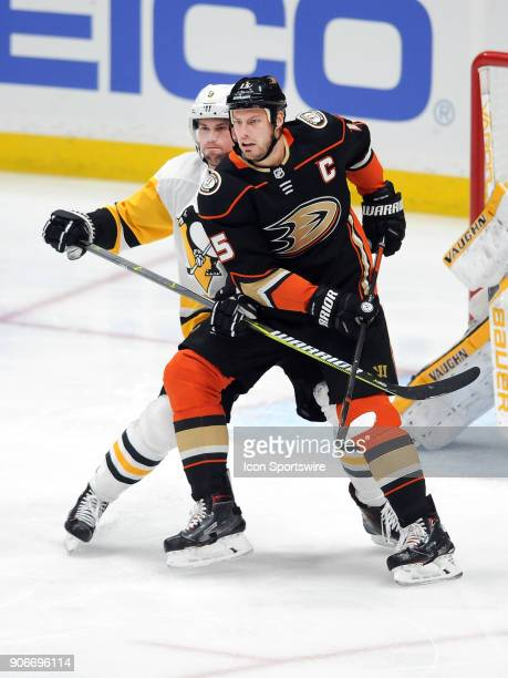 Anaheim Ducks captain Ryan Getzlaf stays in front of Pittsburgh Penguins defenseman Brian Dumoulin in the first period of a game played on January 17...