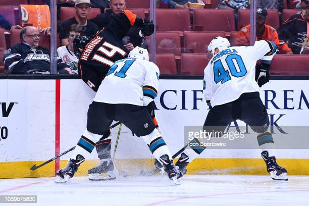 Anaheim Ducks center Adam Henrique is checked by San Jose Sharks defenseman Radim Simek and center Antti Suomela during a NHL preseason game between...