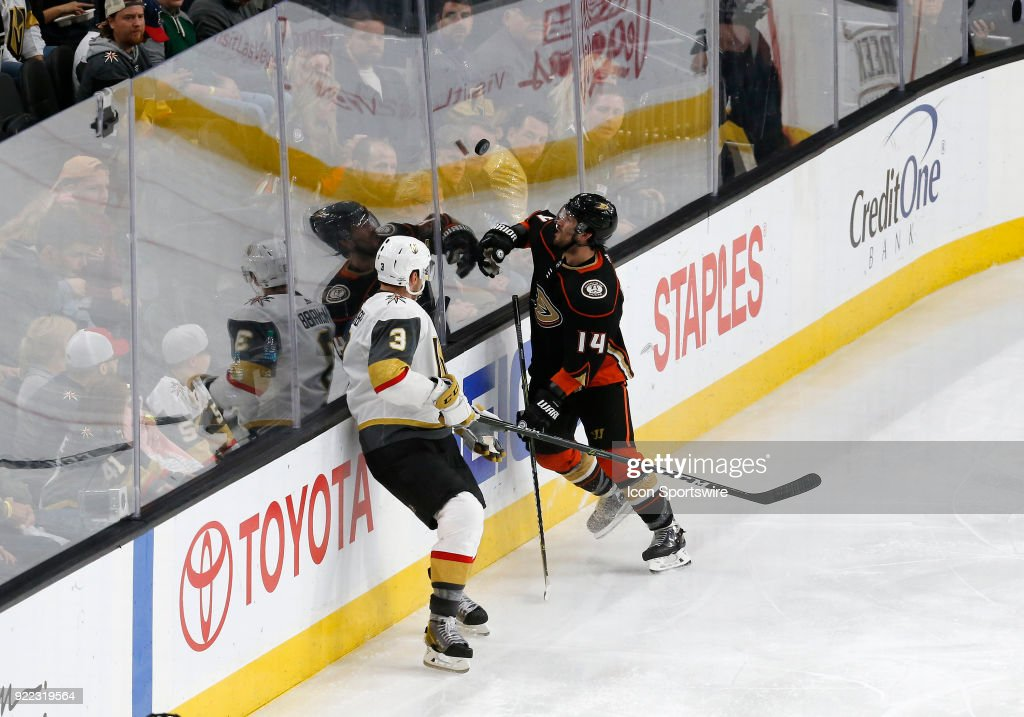 Anaheim Ducks center Adam Henrique (14) watches the puck fly along the plexiglass during the third period of a regular season NHL game between the Anaheim Ducks and the Vegas Golden Knights at T-Mobile Arena Monday, Feb. 19, 2018, in Las Vegas, Nevada. The Anaheim Ducks would defeat the Vegas Golden Knights 2-0.
