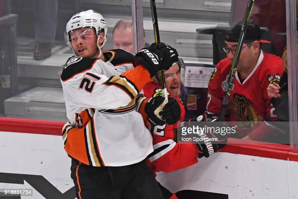 Anaheim Ducks center Chris Wagner checks Chicago Blackhawks defenseman Jordan Oesterle into the boards in the third period during a game between the...